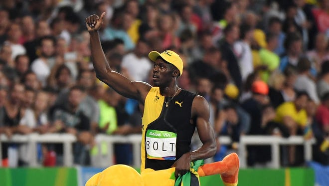 Usain Bolt acknowledges the cheers.