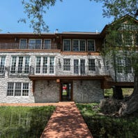 Home hugging Orchard Lake is an engineering wonder surrounded by nature