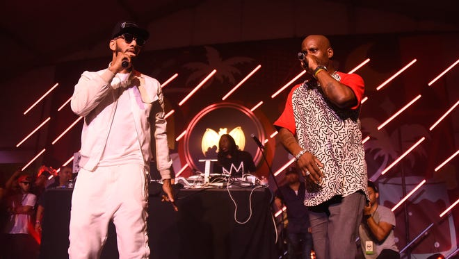 "Swizz Beatz (L) and DMX perform on stage  in Miami Beach. DMX released a well-received version of ""Rudolph The Red Nosed Reindeer."""