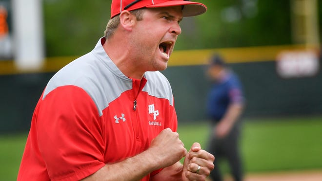 RON JOHNSON/JOURNAL STAR Morton head coach Jesse Crawford, tries to fire up his players 9in the 6th inning of Wednesday's Mid-Illini game with Limestone.