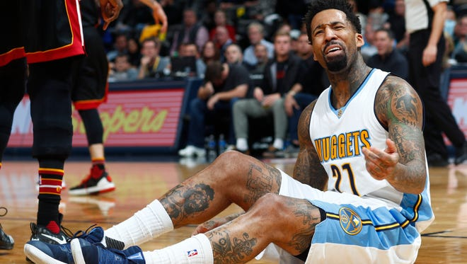 Denver Nuggets forward Wilson Chandler reacts after no foul was called against the Miami Heat on his drive to the basket on Wednesday. As has been the case since George Karl left the Nuggets, professional basketball is struggling in Denver.