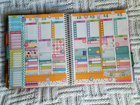 Katy Halliday's day planner looks a bit more like a scrap book than a calendar but it keeps her on task.