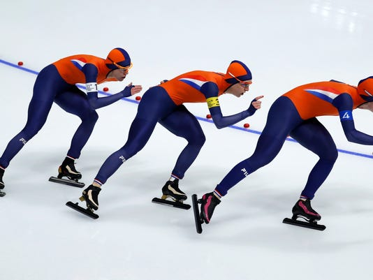 Team Netherlands with Marrit Leenstra, left, Ireen Wust, center, and Antoinette de Jong, right, competes during the quarterfinals of the women's team pursuit speedskating race at the Gangneung Oval at the 2018 Winter Olympics in Gangneung, South Korea, Monday, Feb. 19, 2018. (AP Photo/John Locher)