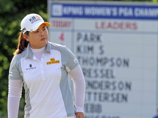 Inbee Park stands on the 17th green  during the final round KPMG Women's PGA Championship at Westchester Country Club June 14, 2015. Park won the tournament with a score of 19 under par.