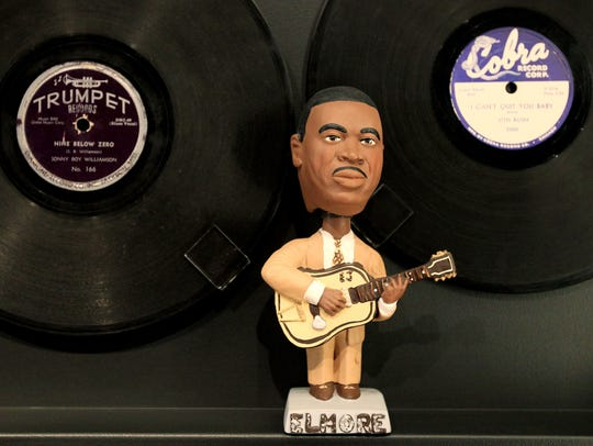 May 5, 2015 - A bobble head of Elmore James sits under