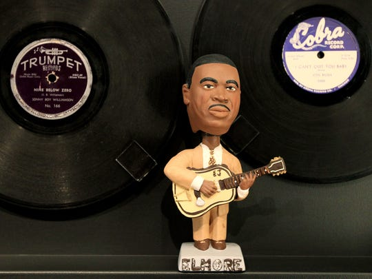 May 5, 2015 - A bobble head of Elmore James sits under 78 RPM records by Sonny Boy Williamson and Otis Rush in a display at the Blues Music Hall of Fame on South Main. The museum opens with a preview on Thursday and will be open to the public on Friday. (Mike Brown/The Commercial Appeal)