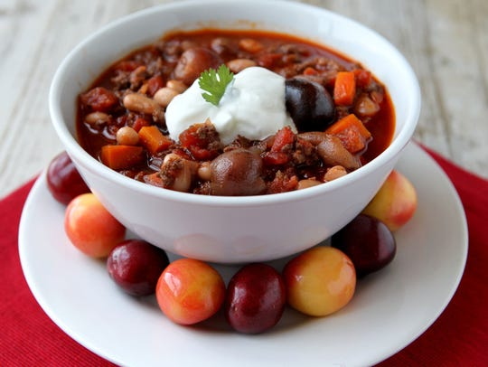 Cherry and chipotle pepper turkey chili, topped with