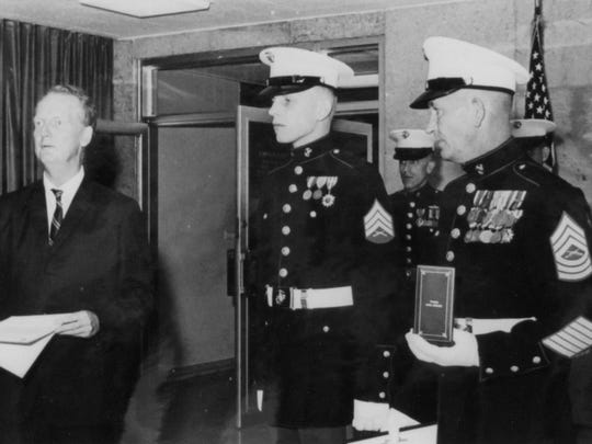 Ron Harper, center,  receives the Bronze Star for his service as a U.S. Embassy guard in Saigon during the Tet Offensive.