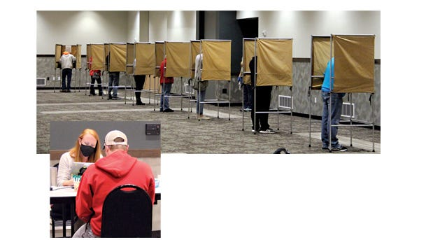 (Top) Voter turnout was brisk Tuesday morning at the Sleepy Eye Event Center with over 160 voters through the doors in the first 90 minutes. (Below) New Election Judge, Lindsey Lepke, assisted those registering to vote.