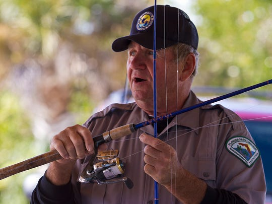 Mark Dahl, a volunteer at Lovers Key State Park, discusses some of the differences in monofilament lines during a free fishing clinic. The popular clinic returns Tuesday.