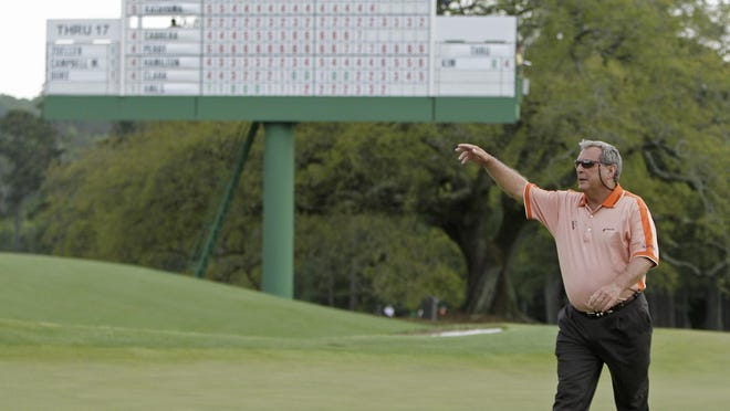 Fuzzy Zoeller waves to the gallery as he walks up the 18th fairway during the second round of the Masters golf tournament at the Augusta National Golf Club in Augusta, Ga., Friday, April 10, 2009.