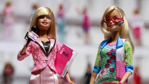 FILE - In this Feb. 14, 2010 file photo, news anchor Barbie, left, and computer engineer Barbie are arranged for a photo at the New York Toy Fair. A new study published Thursday, Jan. 26, 2017, in the journal Science suggests that girls as young as 6 can be led to believe that men are inherently smarter and more talented than women, making them less motivated to pursue novel activities and ambitious careers. That such stereotypes exist is hardly a surprise, but the findings show that the biases can affect children at a very young age.