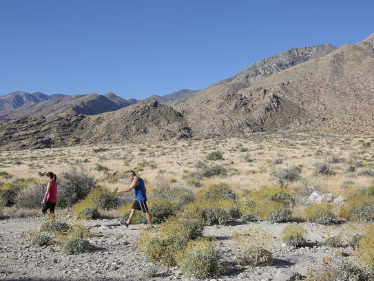 Hikers take a trail in the Oswit Canyon in southwest