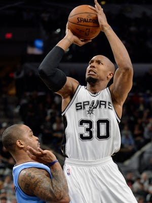 San Antonio Spurs forward David West (30) shoots against Denver Nuggets guard Jameer Nelson during the second half of an NBA basketball game, Wednesday, Nov. 18, 2015, in San Antonio. San Antonio won 109-98. (AP Photo/Darren Abate)