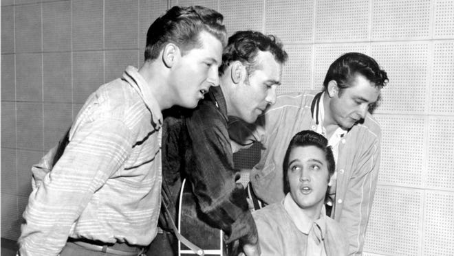 The original Million Dollar Quartet. Elvis is at the piano. Behind him, left to right, are Jerry Lee Lewis, Carl Perkins, and Johnny Cash.