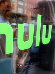 "This Saturday, June 27, 2015, file photo, shows the Hulu logo on a window at the Milk Studios space in New York, where a replica of the ""Seinfeld"" set was on display."