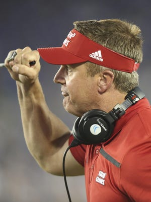 UL coach Mark Hudspeth celebrates his team's touchdown against Kentucky on Sept. 5.