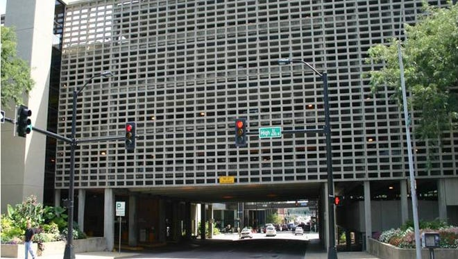 The city of Des Moines plans to demolish this parking garage spanning Seventh Street and build a new parking structure directly to the west at the corner of Seventh and Grand Avenue.