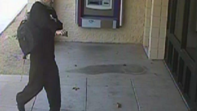 "The ""Goldeneye Bandit"" robbing Deer Valley Credit Union on August 25."