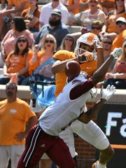 Tennessee wide receiver Jeff George (19) has the ball knocked away by UMass cornerback Isaiah Rodgers (9)  during the second half of their 17-13 win over  UMass Minutemen Saturday, Sep. 23, 2017 at Neyland Stadium in Knoxville, Tenn.