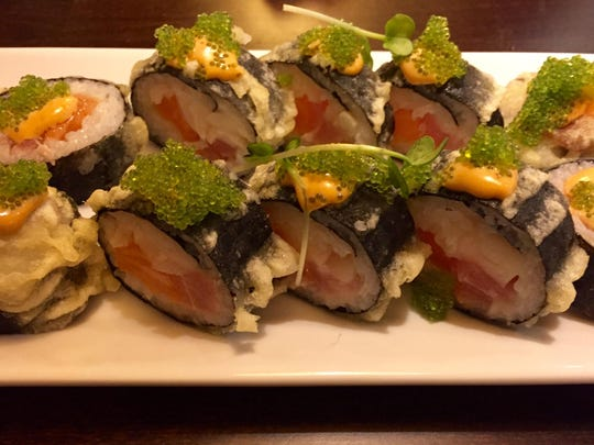 The 4th Street roll at Bukko features ahi, escolar, tempura and spurts of chipotle mayonnaise.