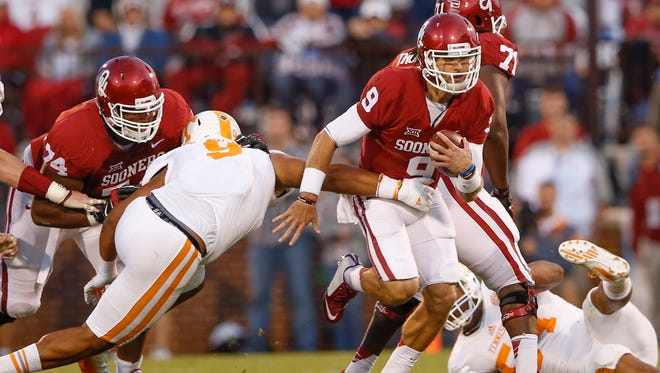 Sep 13, 2014; Norman, OK, USA; Oklahoma Sooners quarterback Trevor Knight (9) runs during the first quarter against the Tennessee Volunteers at Gaylord Family - Oklahoma Memorial Stadium. Mandatory Credit: Kevin Jairaj-USA TODAY Sports