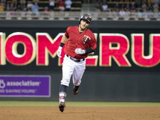 Minnesota Twins left fielder Robbie Grossman (36) rounds second base after hitting a home run in the fifth inning Tuesday against the Houston Astros at Target Field in Minneapolis.