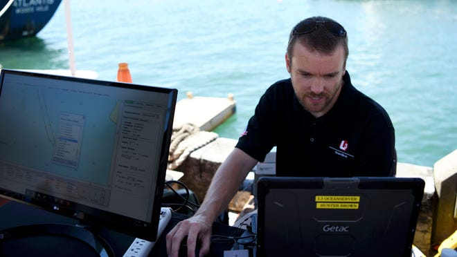 Hunter Brown of L3 Ocean Server sits behind his computer during the fourth annual Marine Robotics Entrepreneurs Showcase at Woods Hole Oceanographic Institution in 2018. More research is being done to gauge the impact of blue technology and research on the U.S. economy.