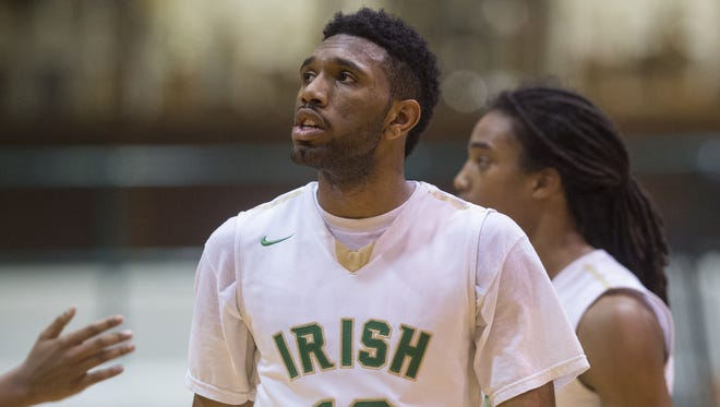 Indianapolis Cathedral High School senior Eron Gordon (10) looks to the scoreboard as the game nears the end during the second half of a semi-final game in the Indianapolis City Boys' Basketball Tournament, Saturday, Jan. 23, 2016, at Arsenal Technical High School. Cathedral won, 81-73 to advance to Monday's championship game.
