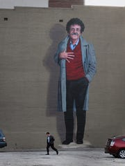A painting of Kurt Vonnegut by artist Pamela Bliss adorns the east wall of the building in the 300 block of Mass Ave.