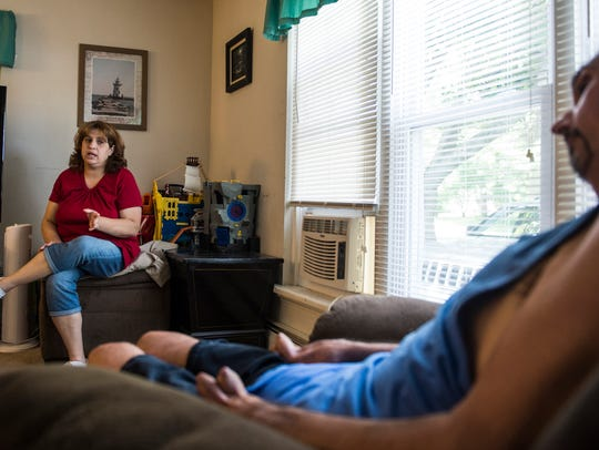 Karen and Mike Giardino talk in their home on Wednesday,