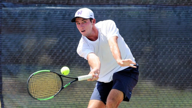 Wylie's Lane Adkins reaches down for a shot during the fourth-round qualifier of the Boys' 18 USTA Texas Slam consolation bracket at Craig Middle School on Tuesday. Adkins won 4-6, 6-1, 11-9.
