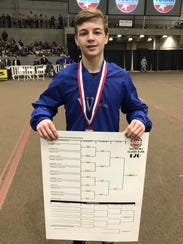 Harpeth's Dylan Becker shows off the bracket from the