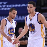 Golden State Warriors guard Stephen Curry (30) celebrates with guard Klay Thompson (11) in a recent win.