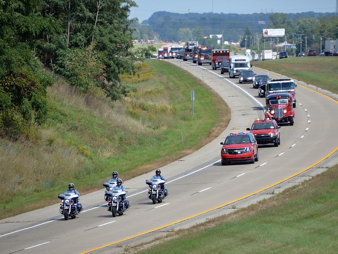 The procession approaches Charlotte, as seen from the