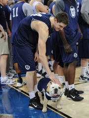 Butler mascot Blue II is petted by Andrew Smith after
