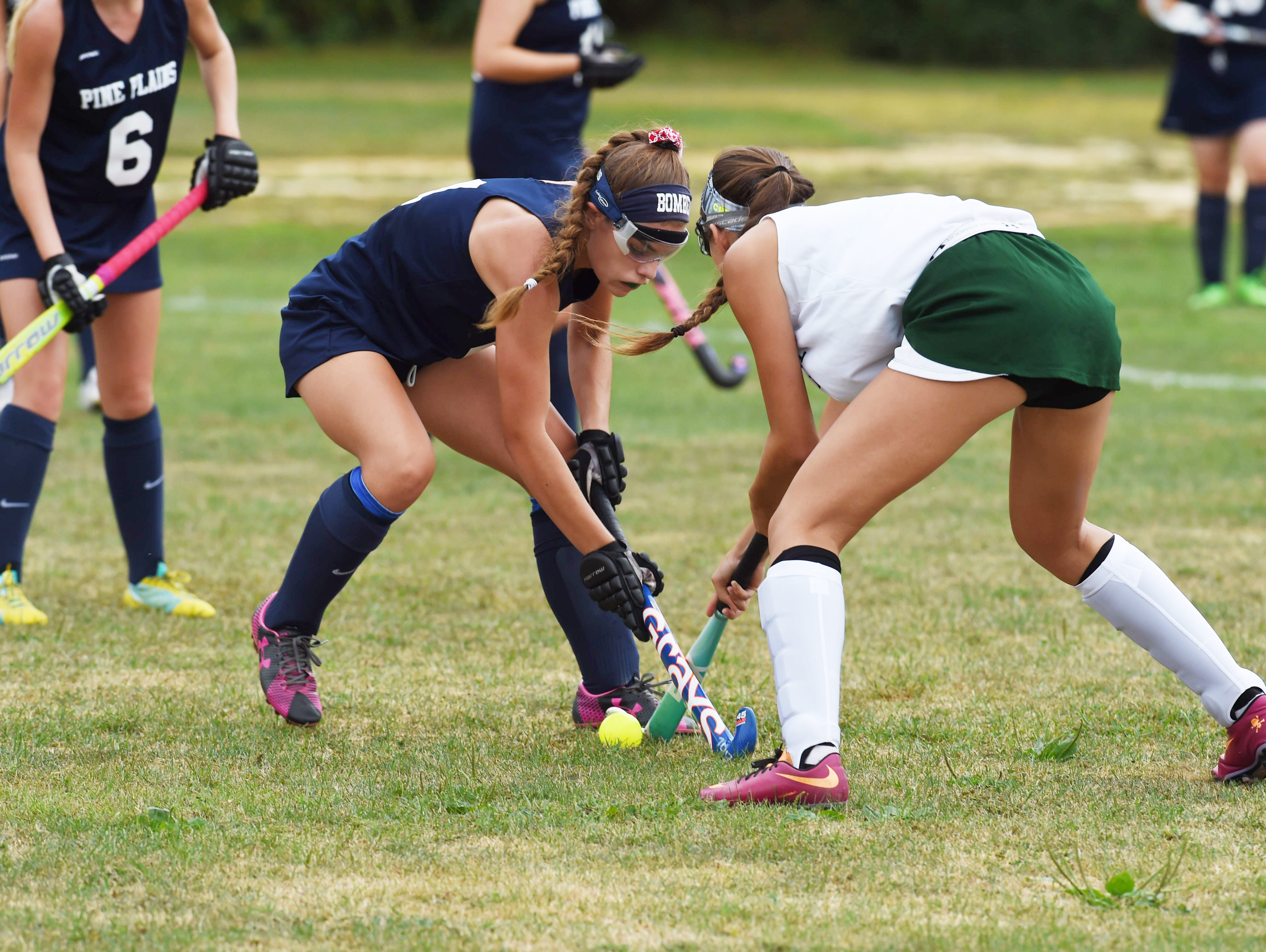 Pine Plains' Holly Bay, left, and Spackenkill's Amanda Izold, right, fight for the ball during Monday's game.