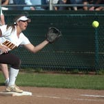 Mercy senior and Miss Softball candidate Abby Krzywiecki makes a putout at first base in the Catholic League final.
