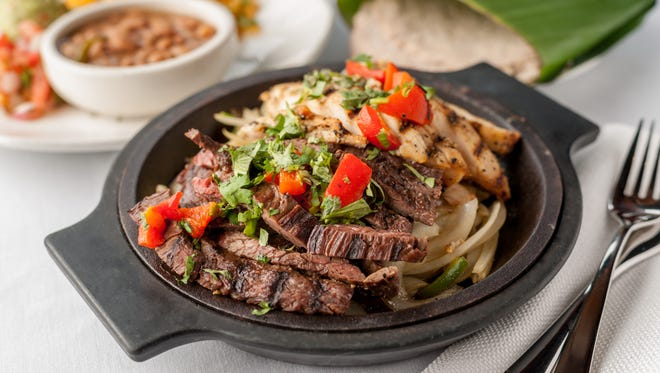 Fajitas, like this Combo Fajitas dish, are the most popular item on the Cantina Laredomenu,