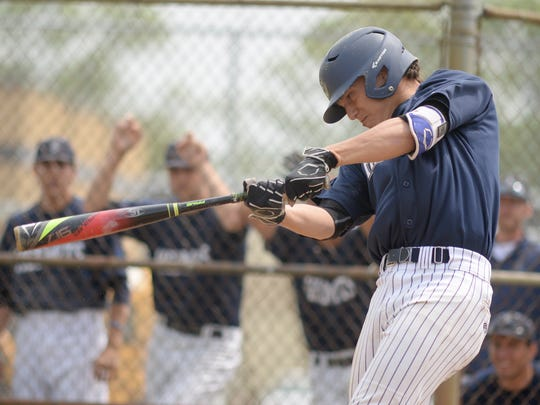 St. Augustine graduate Josh Hood bats during the Diamond Classic in 2018.