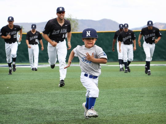 Nevada baseball coach T.J. Bruce's son Jaxon leads the players in a sprint during pregame warmups at Peccole Park in Reno on May 5, 2018.