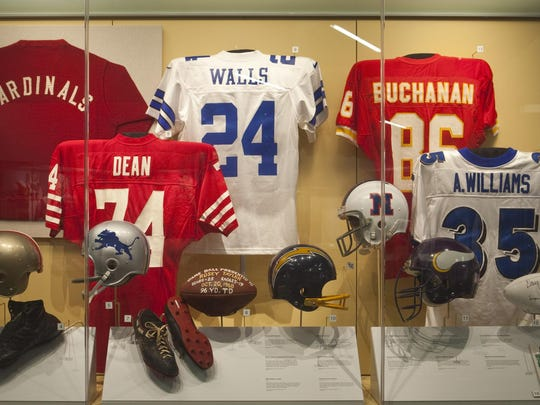 The pro football case at the Louisiana Sports Hall of Fame represents athletes from Louisiana who went on to play professional football, and it showcases, among other things, a size 16-EEE cleat worn by Ernie Ladd, a Pro Bowl helmet worn by Sammie White and a 1934 NFL contract from the Brooklyn Dodgers that former Centenary great Paul Geisler turned down to finish school.