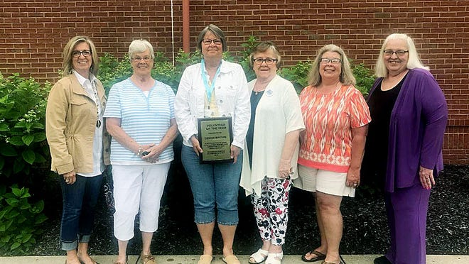 Pathways Hospice's Volunteer of the Year, Denise Brown, holds her award surrounded by fellow volunteers (from left) Kathy Baldner, Fay Boes, Nancy Tallmadge, Amy Metzger and Volunteer Coordinator Sharon Secura.