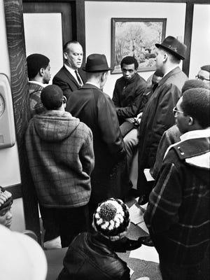 Students and President of the Wisconsin State University at Oshkosh, now the University of Wisconsin Oshkosh, talk on November 21, 1968. It was dubbed Black Thursday.