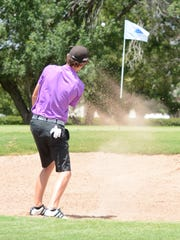 Merkel senior-to-be Colton Hilburn hits out of a sand