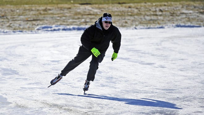 Michael Kading, Neenah's parks and recreation director takes to the ice with speed skates during the Washington Park Winter Festival on Jan. 13 at the renovated Washington Park in Neenah.