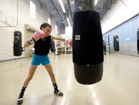 Ivy Enriquez, 9, works out at the Carolina Recreation