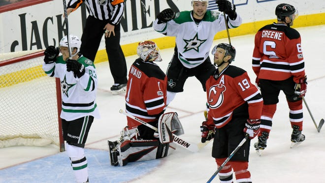 Dallas Stars right wing Ales Hemsky (83) celebrates his goal to tie the game with teammate Devin Shore (17) as New Jersey Devils goalie Keith Kinkaid (1), Travis Zajac (19) and Andy Greene (6) react during the third period of an NHL hockey game Sunday, March 26, 2017, in Newark, N.J. (AP Photo/Bill Kostroun)