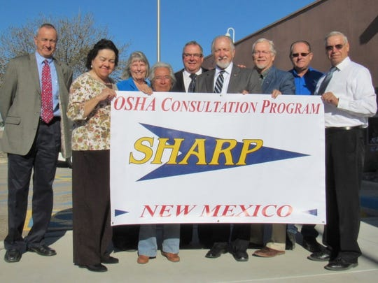 After the award ceremony, the SCSWA board holds up the SHARP banner. The facility was the first in state to win the award.
