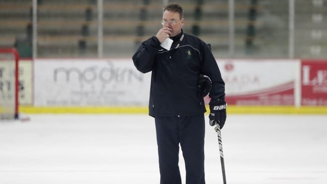 St. Norbert College men's hockey coach Tim Coghlin looks on during practice Tuesday at the Cornerstone Community Center in Ashwaubenon. Tim Coghlin is 529-138-52 in 24 seasons with the Green Knights, who advanced to its 11th NCAA Division III Frozen Four since 2003 this year.